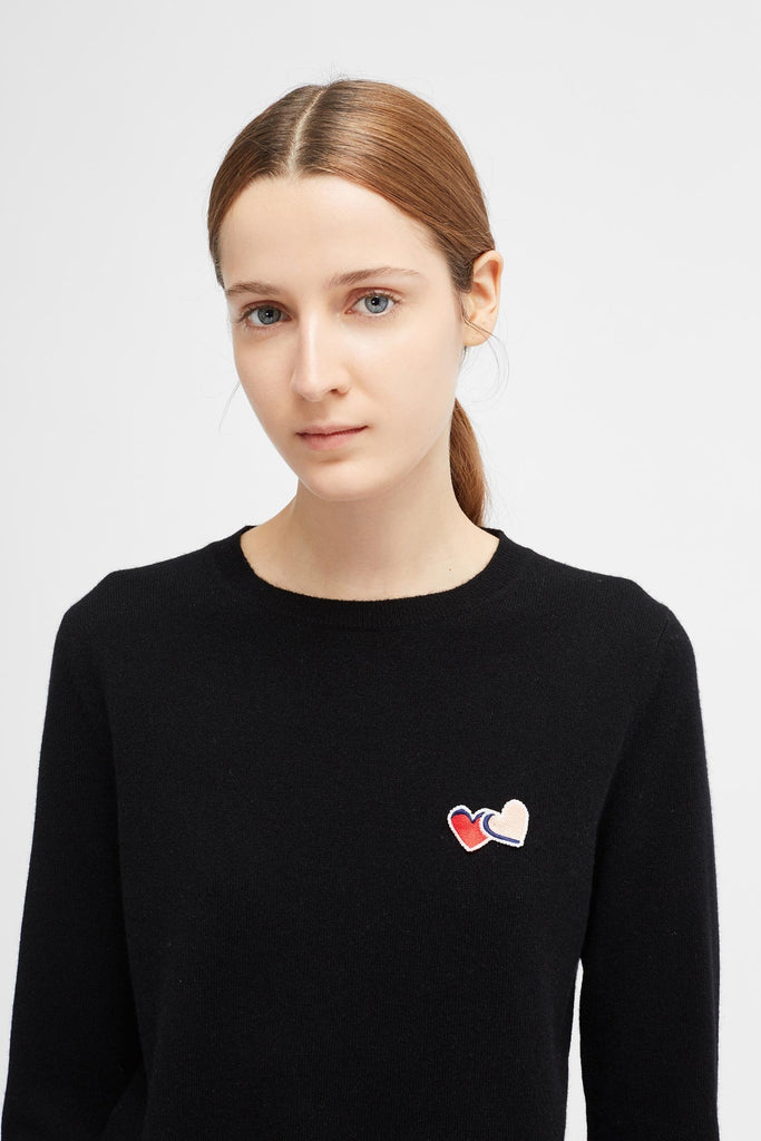 Our mid-weight black 100% cashmere sweater is crafted to a regular-fit shape with a crew neck and ribbed trims. An embroidered Twin Heart badge sits on the chest. 100% cashmere