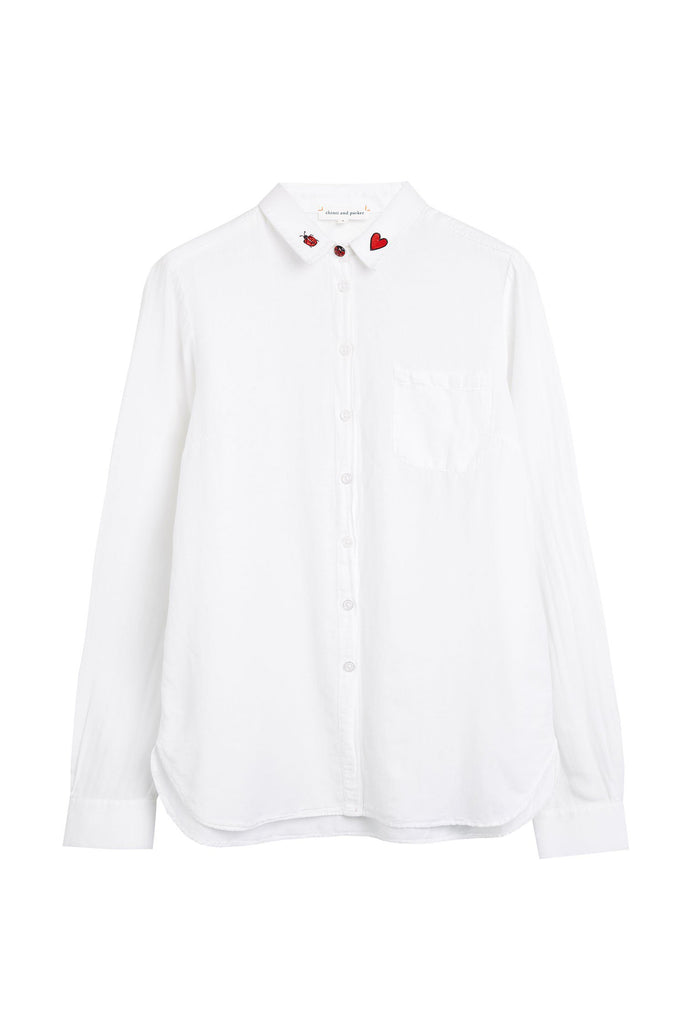 Expertly tailored, this classic white shirt is crafted from a natural cotton-silk blend. Featuring playful motifs on the collar and a shapely shirt-style hem, this stylised wardrobe staple will add a fresh new option to your everyday looks.