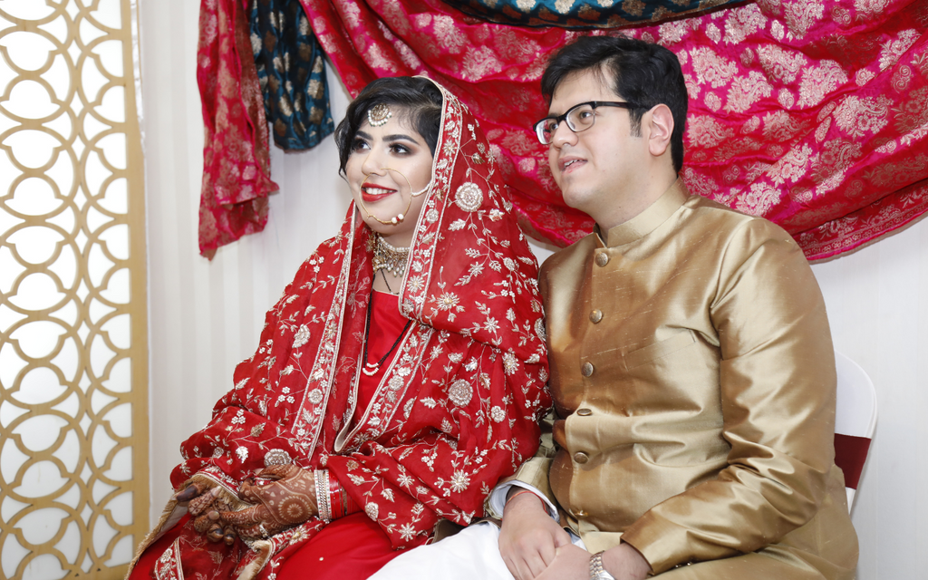 Weaver Story Bride in red silk suit with detailed red Zardozi dupatta