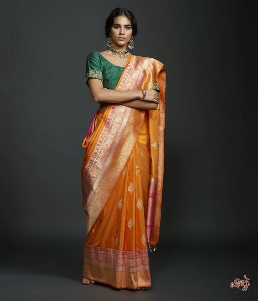 Mango Yellow Dual Tone Kadhiyal Border Saree With A Kadhwa Booti And Pink Selvedge Saree