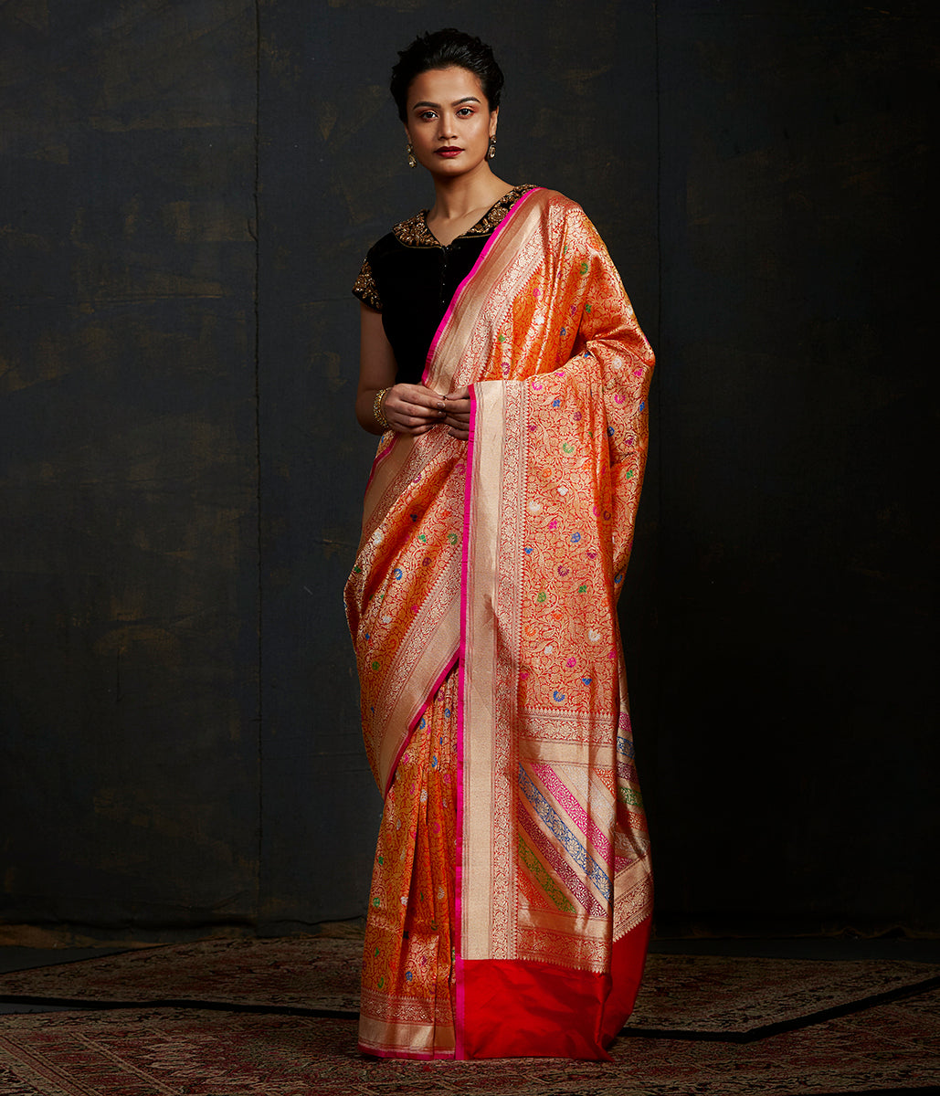Tomato red and gold meenakari kimkhab saree with a bright pink selvedge