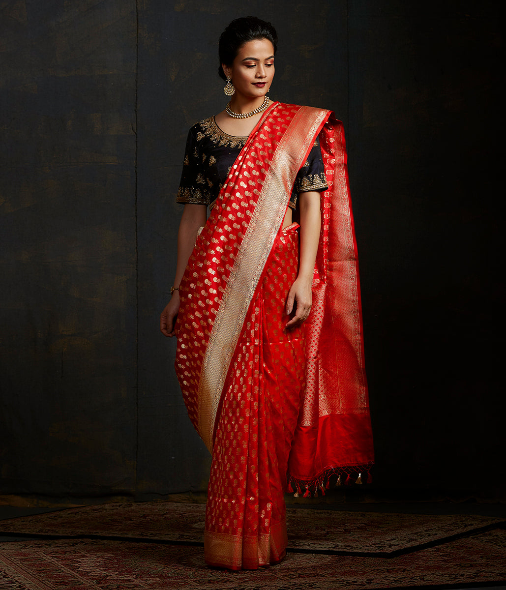 Red katan silk saree with small floral motifs and kadhwa border