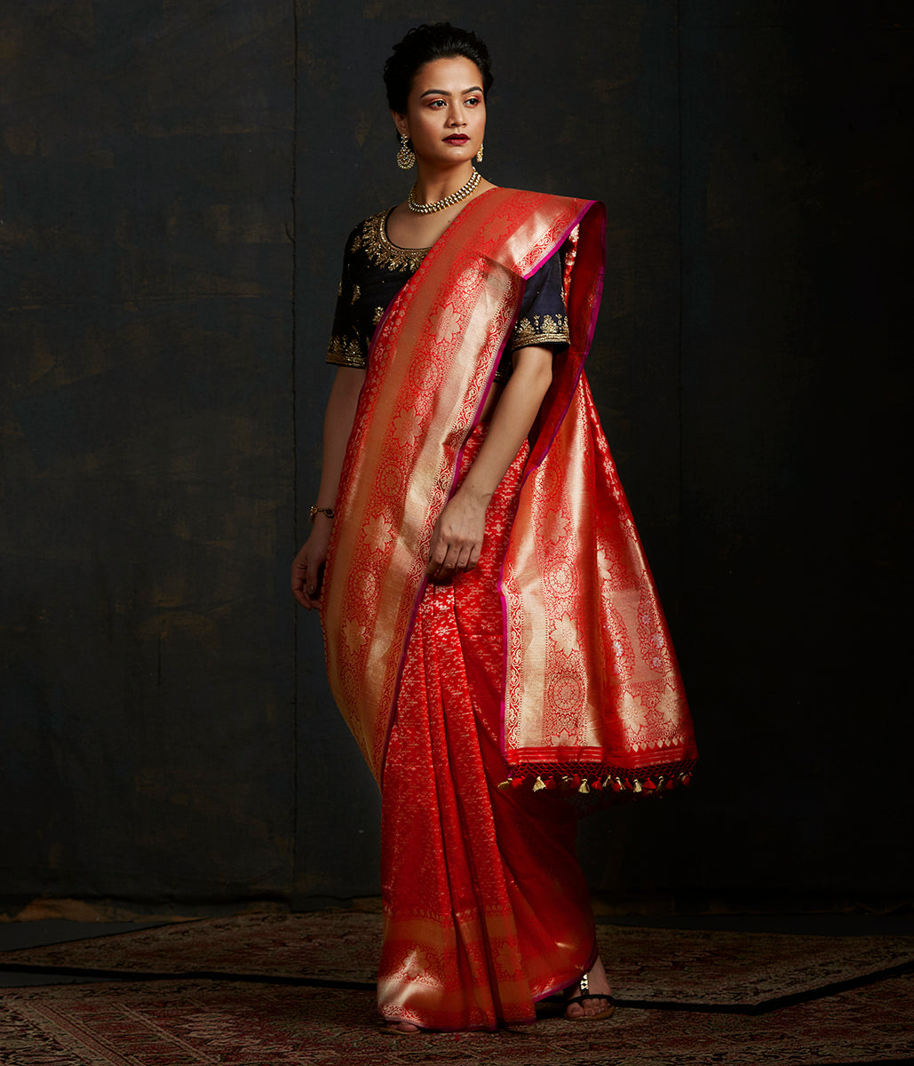 Handwoven Banarasi saree in red with broad floral border