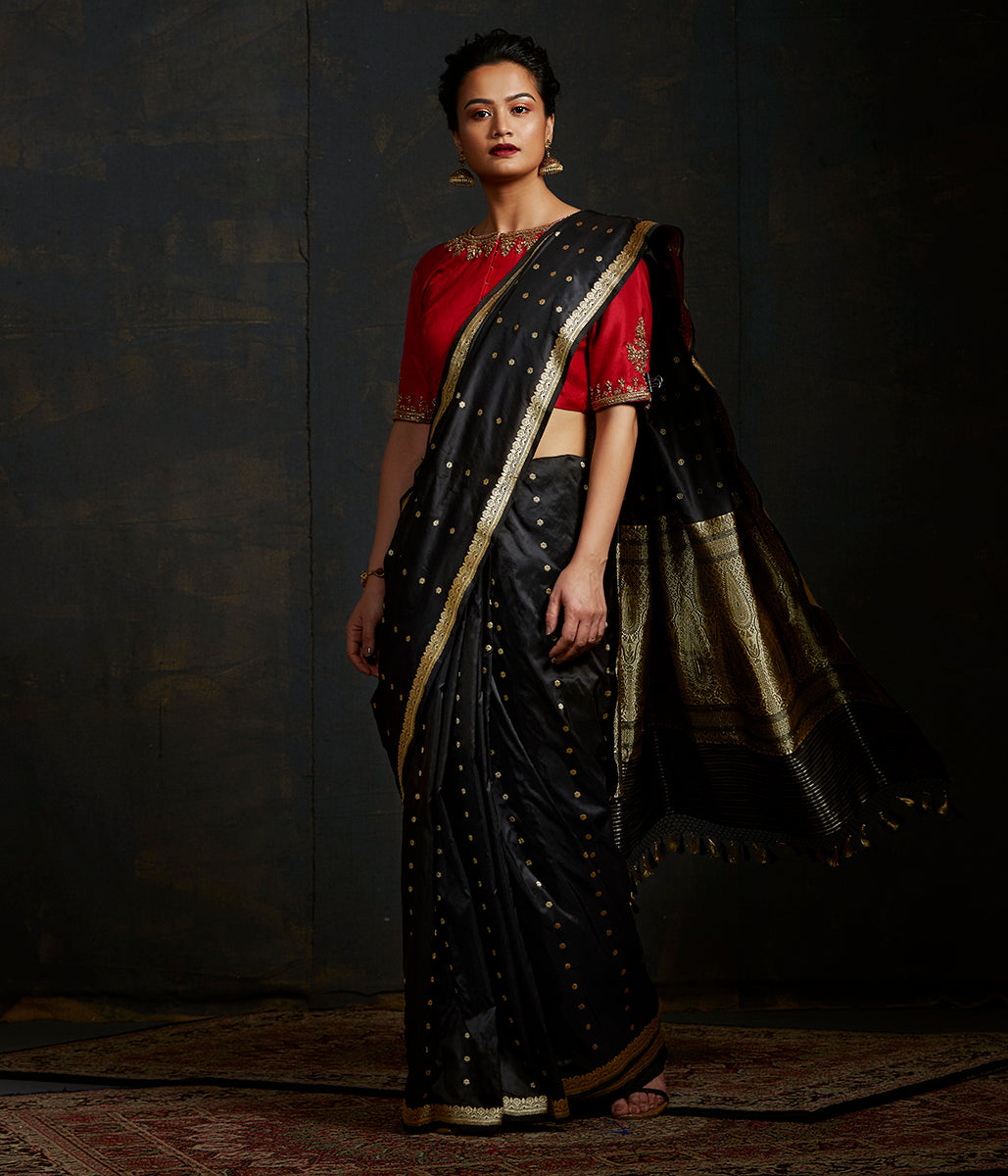 Black katan silk saree with small floral motifs and a delicate kadhwa border