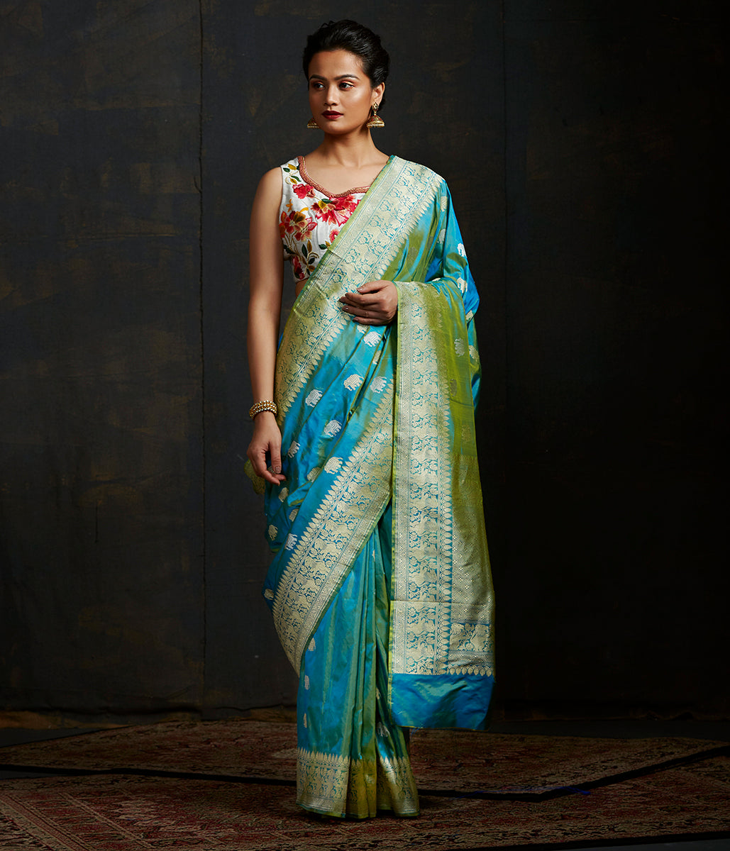 Blue and yellow dual tone kadhwa elephant boota saree with shikargah border