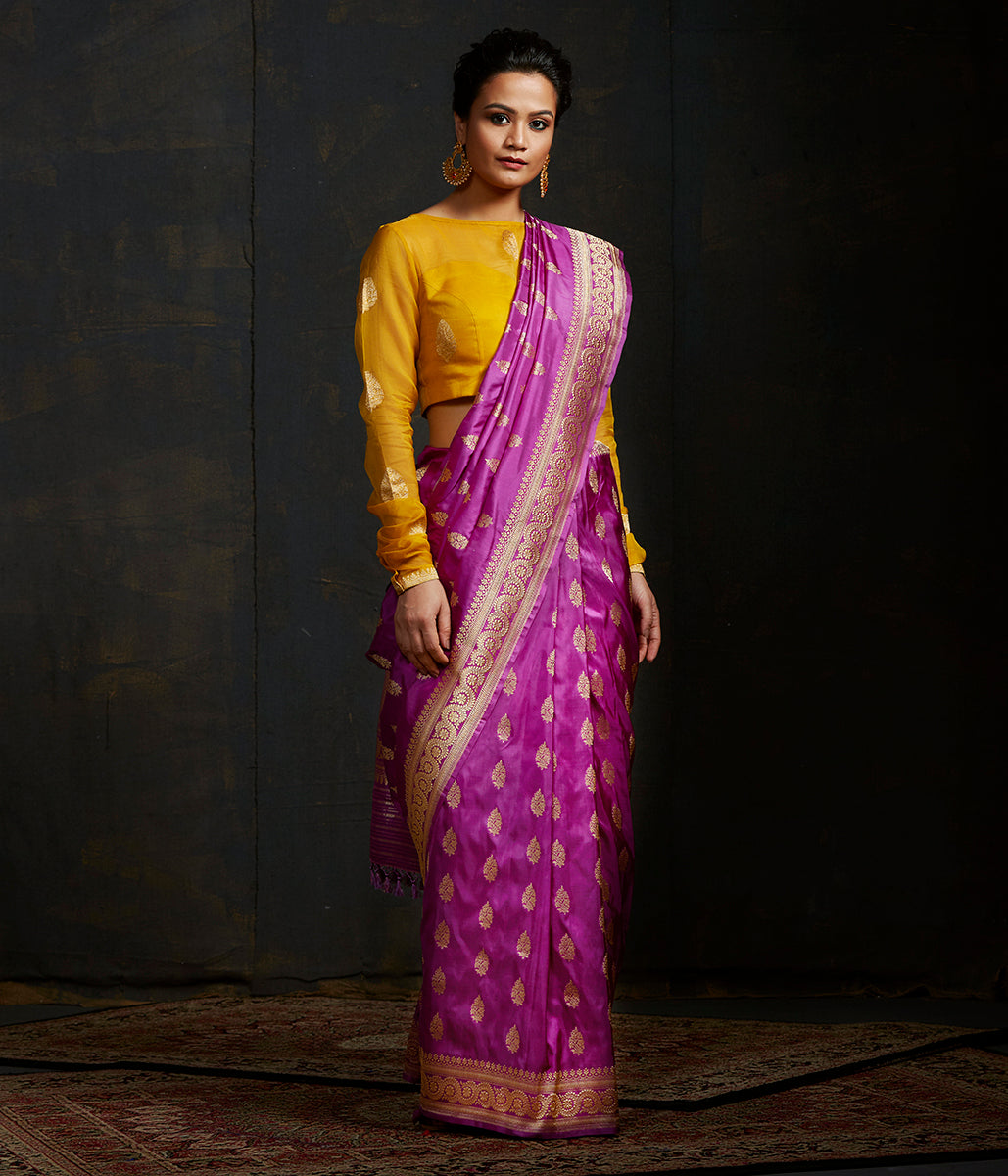 Purple pure katan silk saree with traditional  and floral border