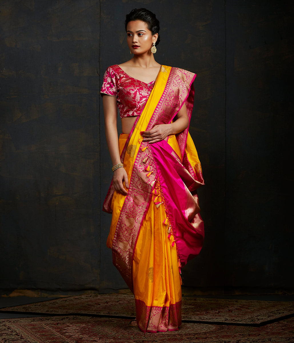 Handwoven kadhwa banarasi saree in yellow with a pink border