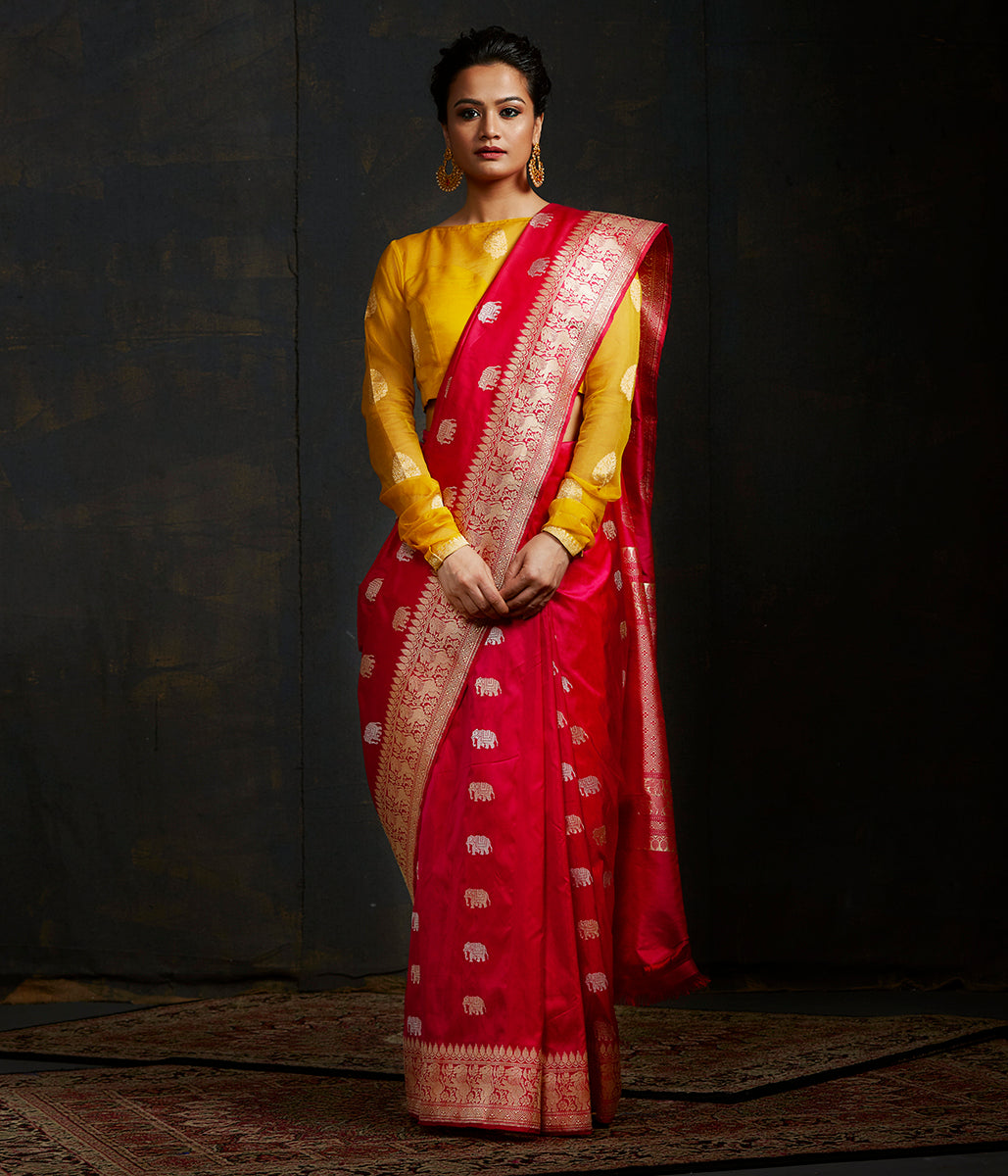 Pink and orange dual tone kadhwa elephant boota saree with shikargah border