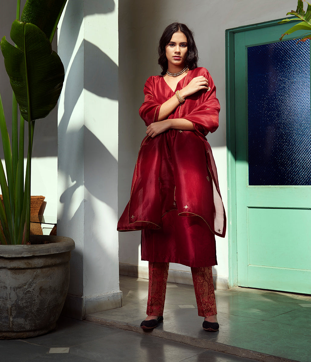 Hand embroidered pure silk suit in mahroon color with Hand embroidery dupatta and brocade/silk pants