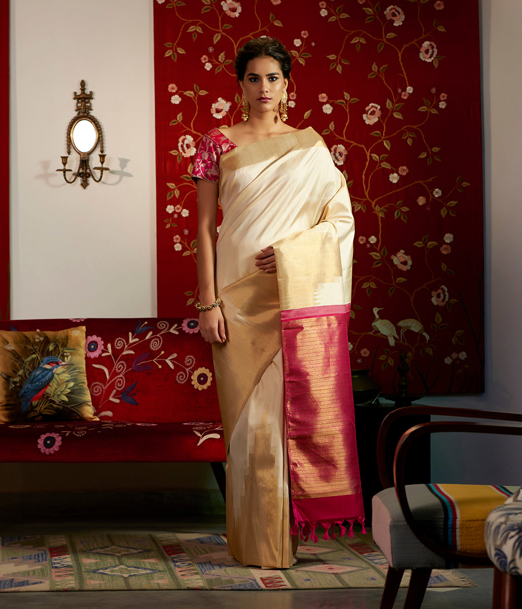 Offwhite and gold kanjivaram saree with rising temple borders in real zari