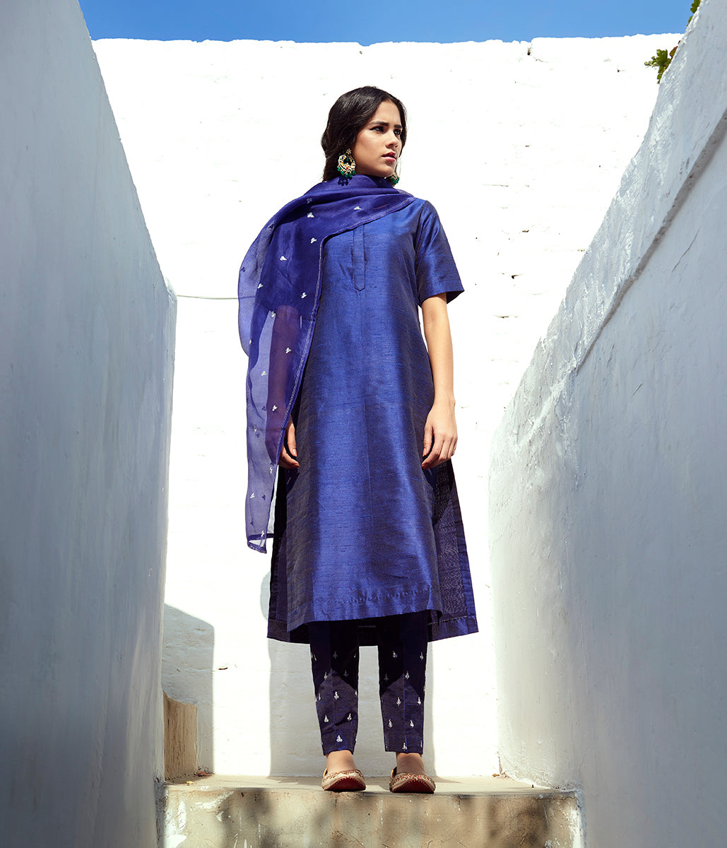 Hand embroidered raw silk suit in navy blue color with Hand embroidery dupatta and silk pants