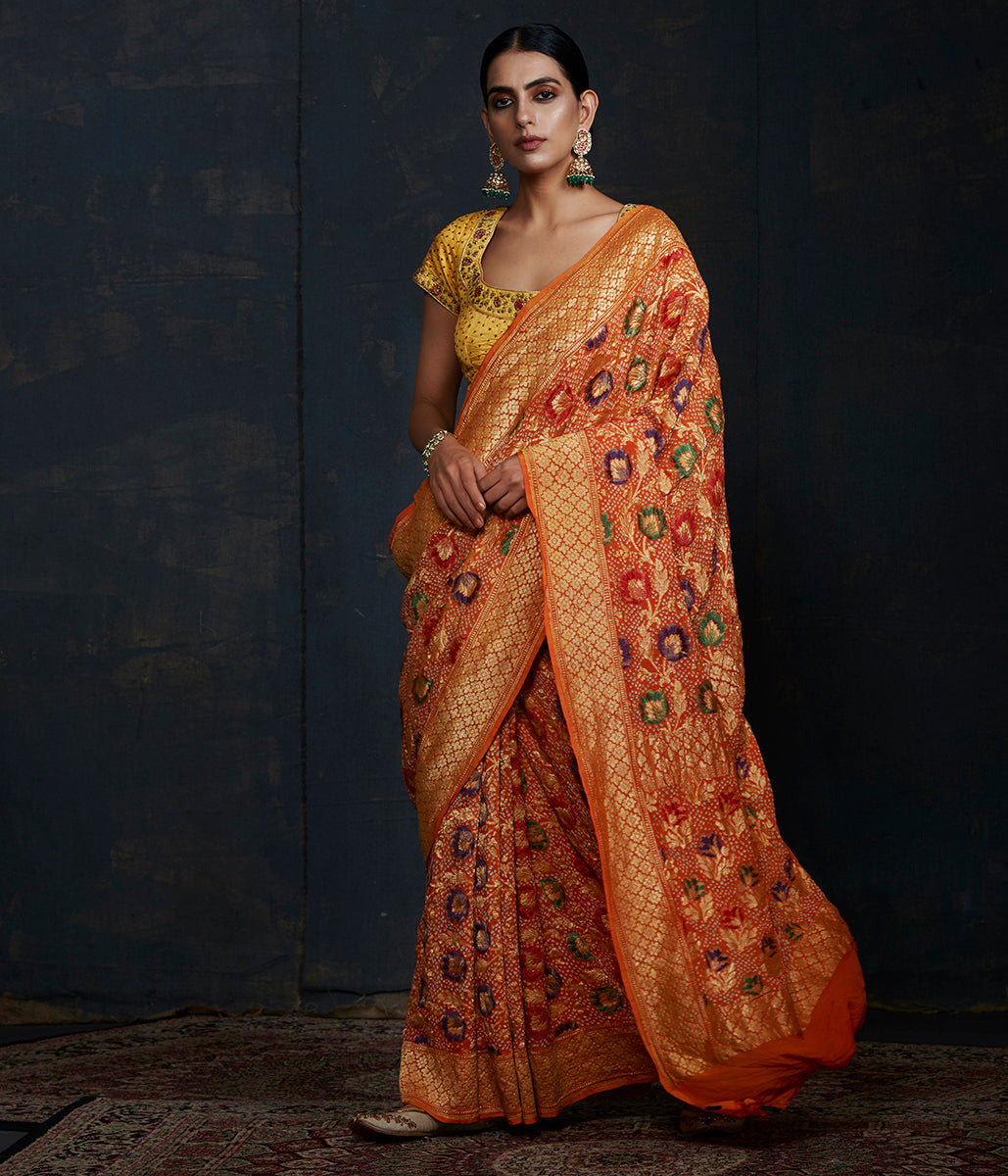 Handwoven Banarasi Bandhej Saree in orange color with meenakari jaal