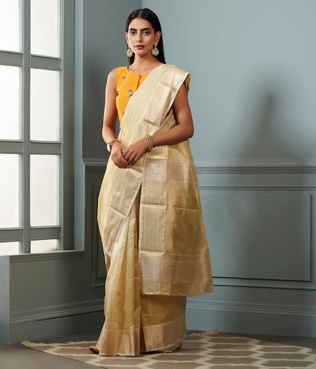 Ivory and gold chanderi tissue silk saree with floral motifs