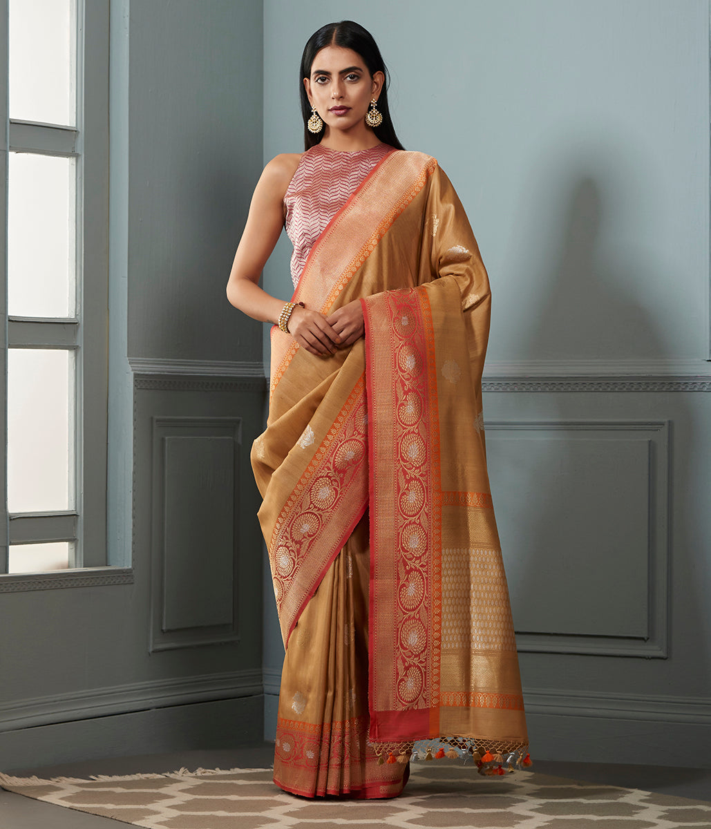 Golden beige tusser silk georgette saree with contrast orange border