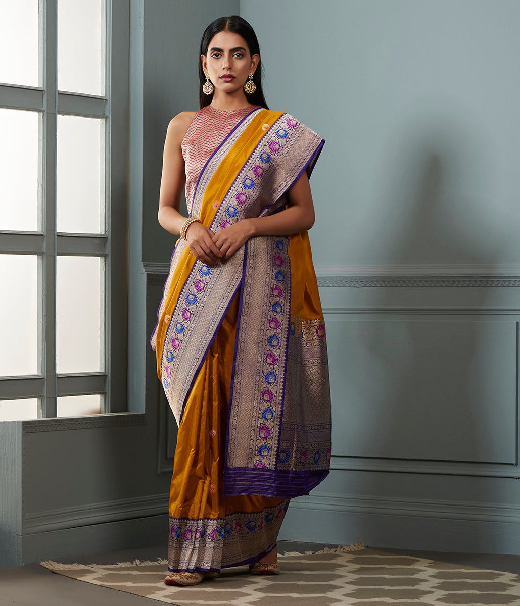 Mustard Yellow katan silk saree with a purple meenakari border