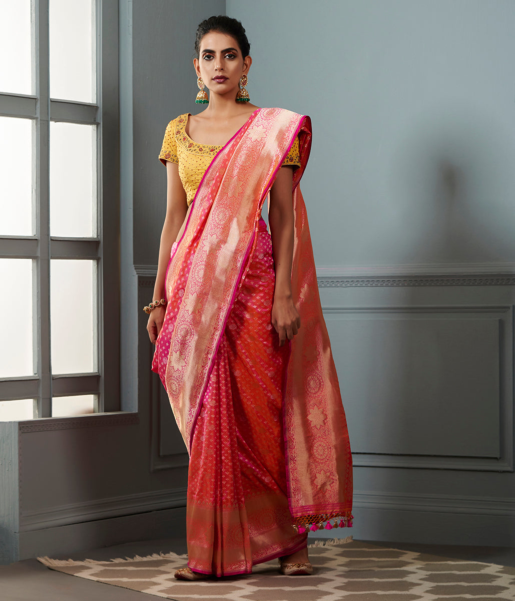 Handwoven Banarasi saree in Pink and peach dual tone with broad floral border