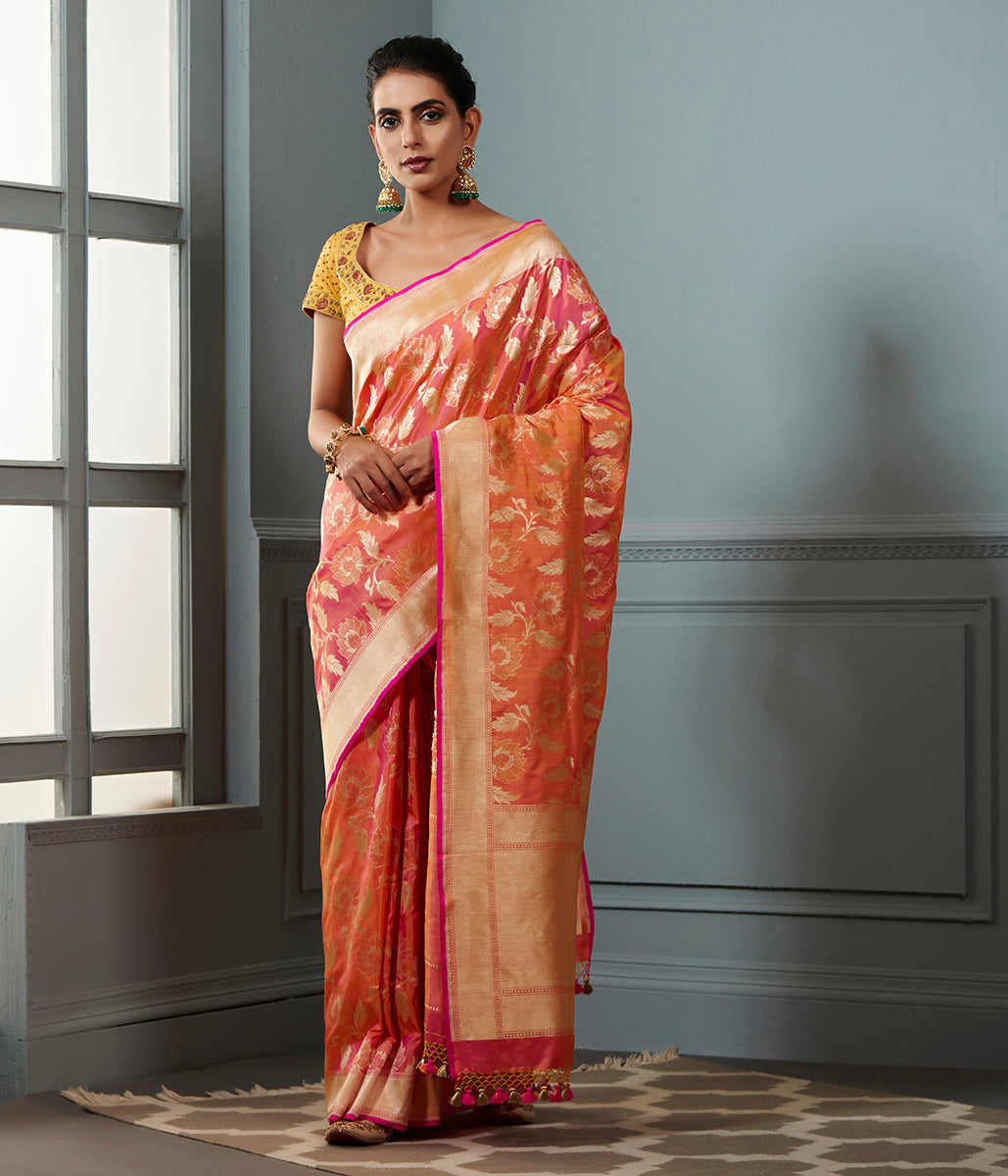Handwoven Banarasi saree in Oramge and peach dual tone with floral jaal