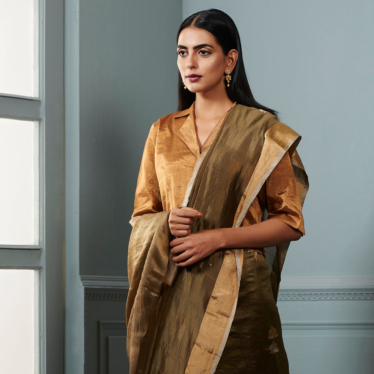 Olive green chanderi silk saree with zari boota and Gold and silver zari border