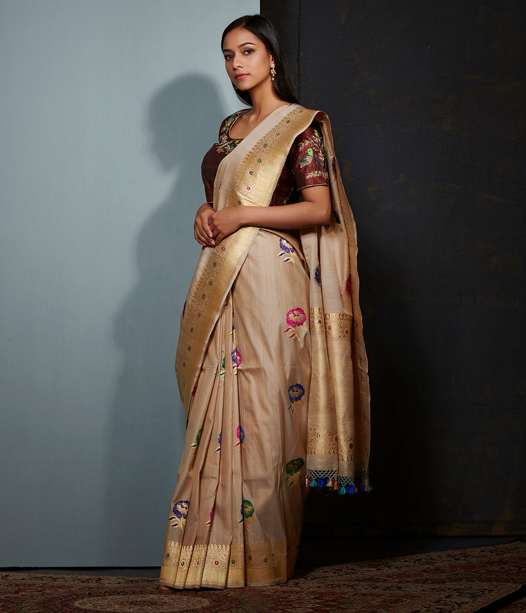 Golden beige tusser silk saree with meenakari floral motifs