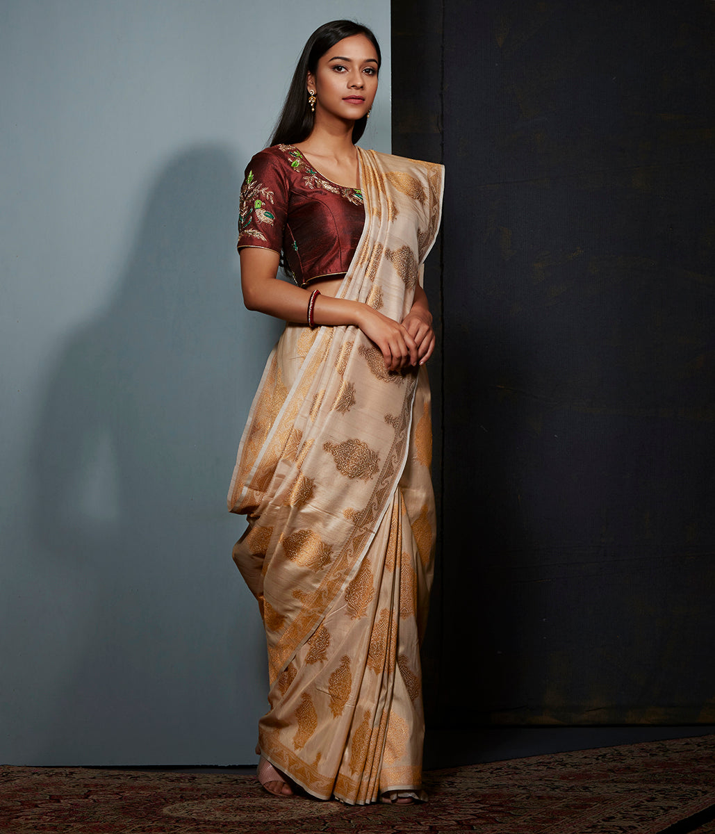 Beige tusser silk saree with kadhwa booti
