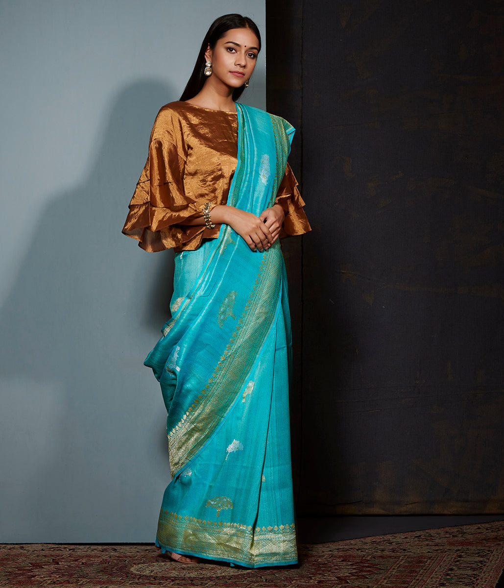 Blue tusser silk and georgette saree with sona rupa zari boota