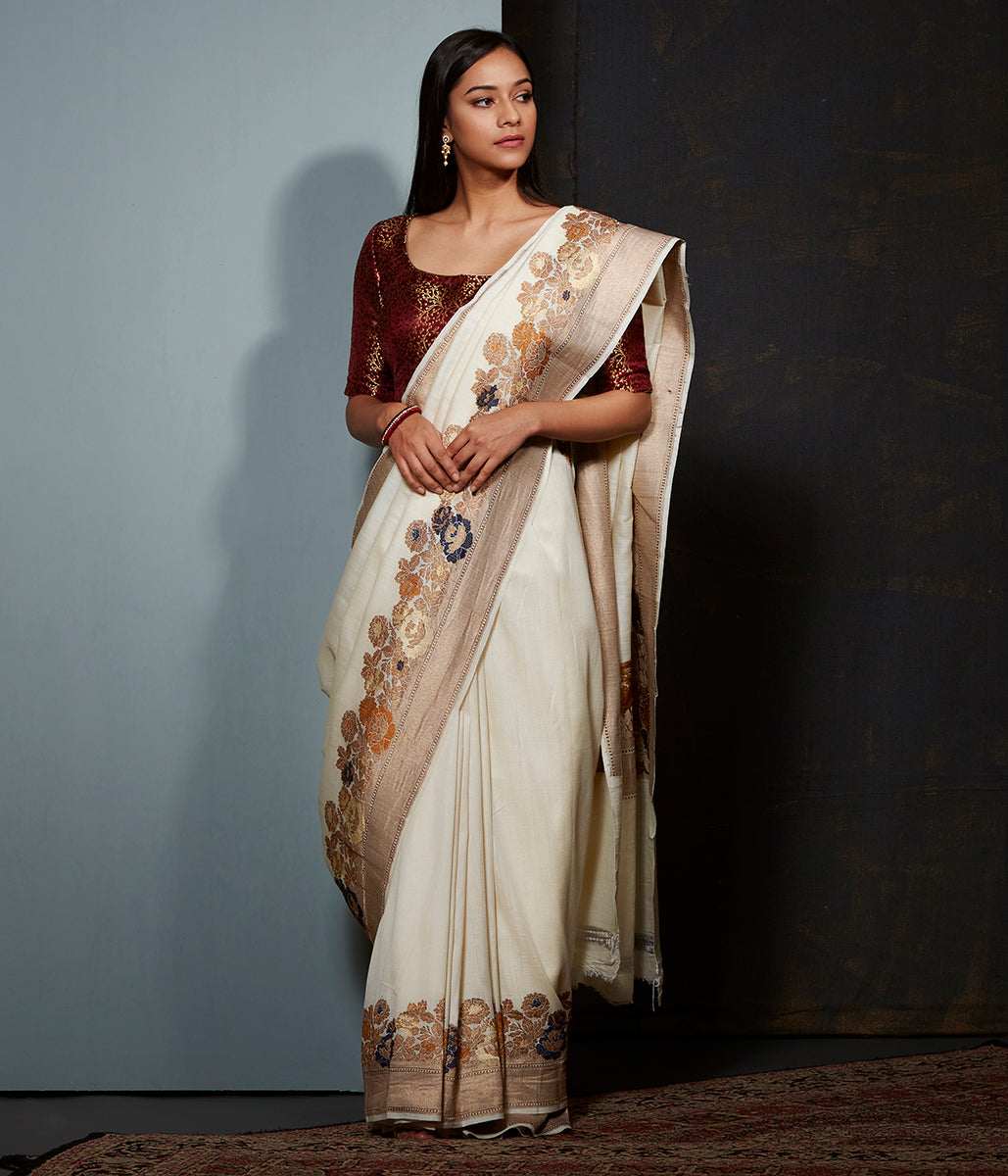 Offwhite munga silk saree with floral meenakari border