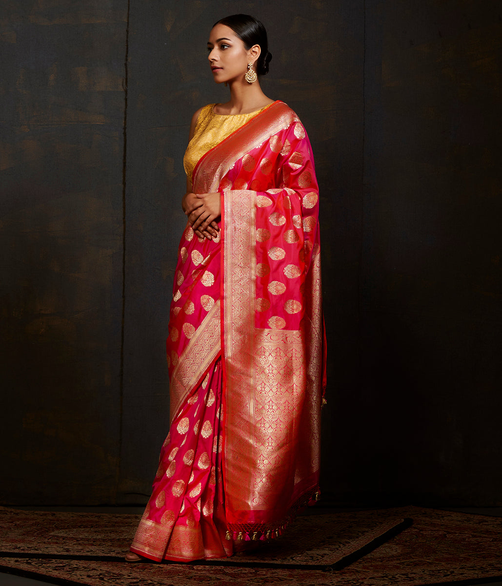 Hot pink and orange katan silk saree with traditional motifs and kadhwa border