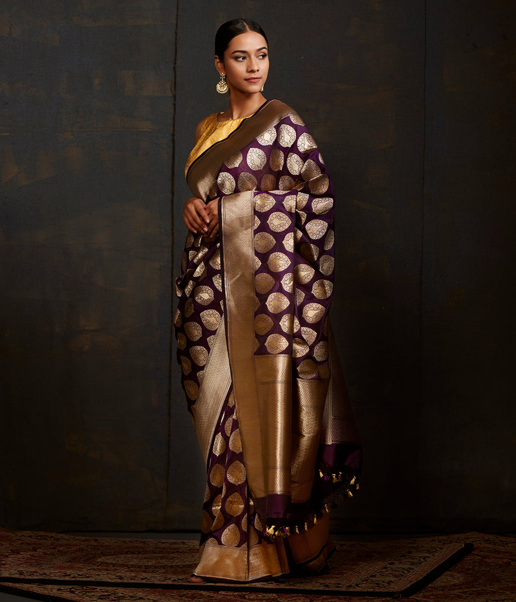 Purple katan silk saree with traditional leaf motifs