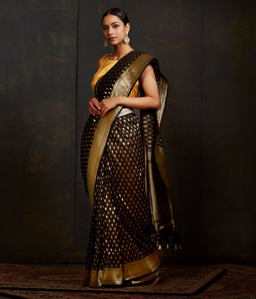 Black katan silk saree with traditional leaf motifs and kadhwa border