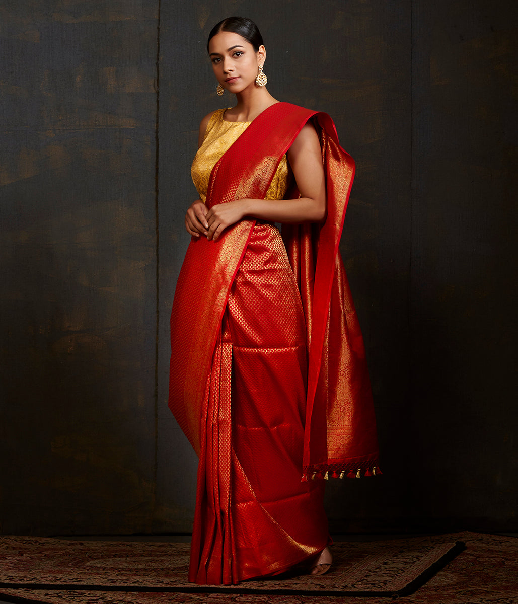 Red katan silk saree with small paisley motifs