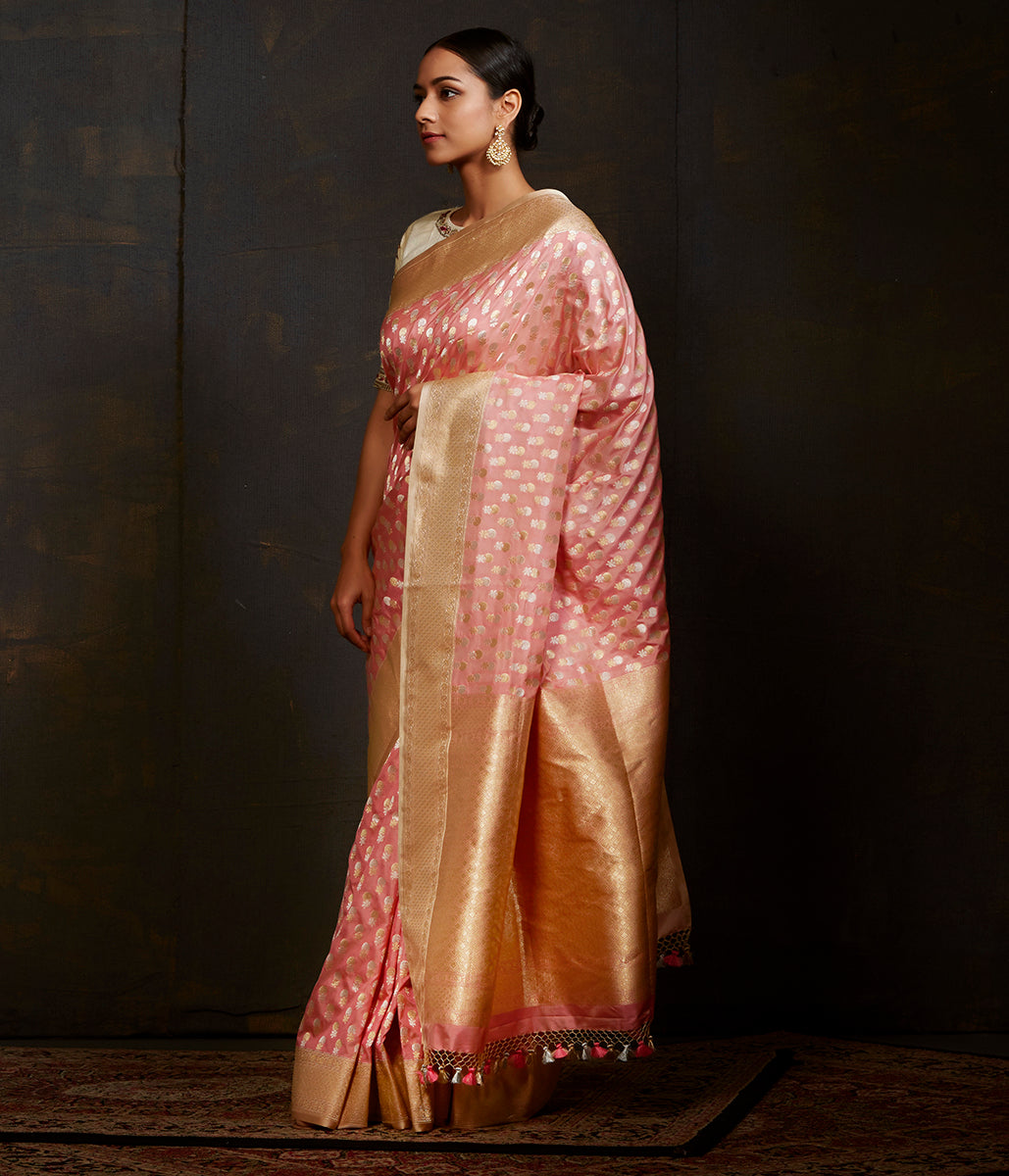 Baby pink katan silk saree with traditional motifs and kadhwa border