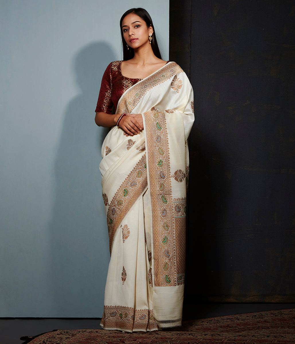 Offwhite munga silk saree with floral meenakari  and antique zari border
