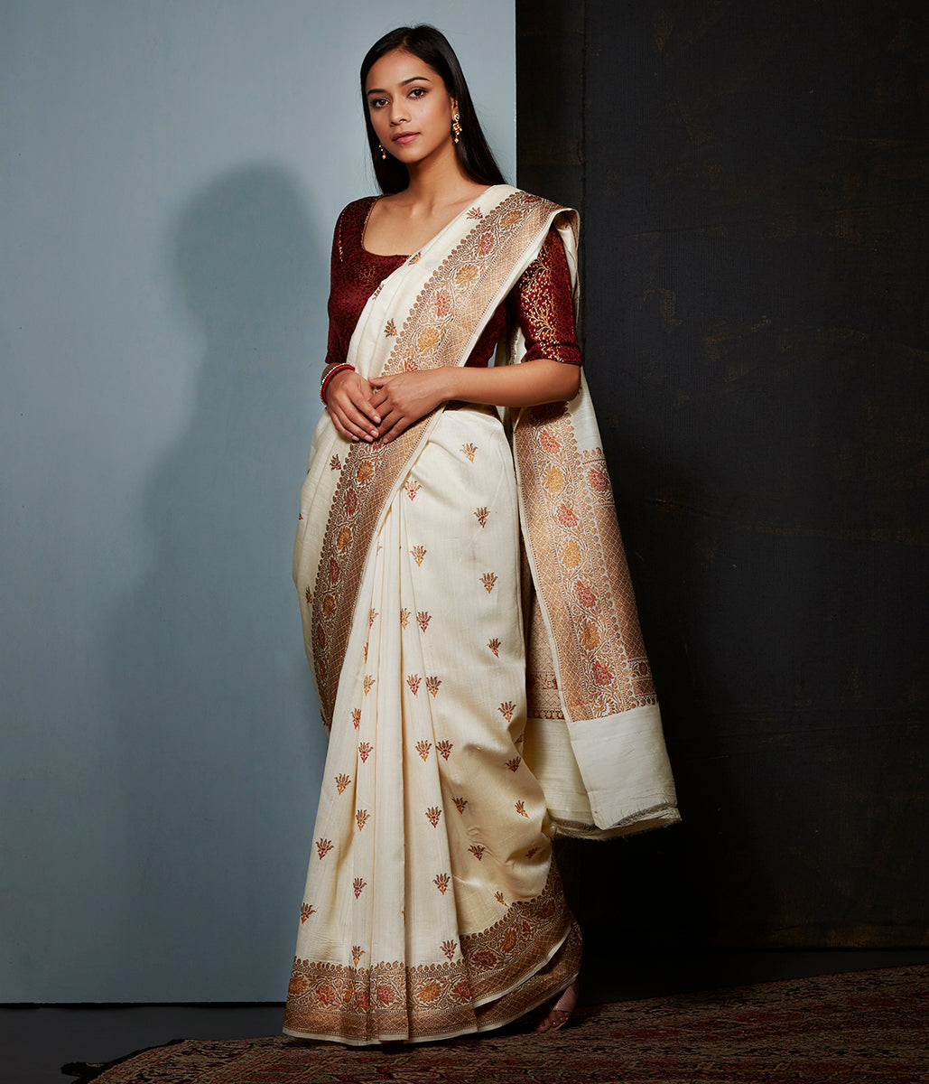 Offwhite munga silk saree with floral meenakari border in rust and mustard and small motifs
