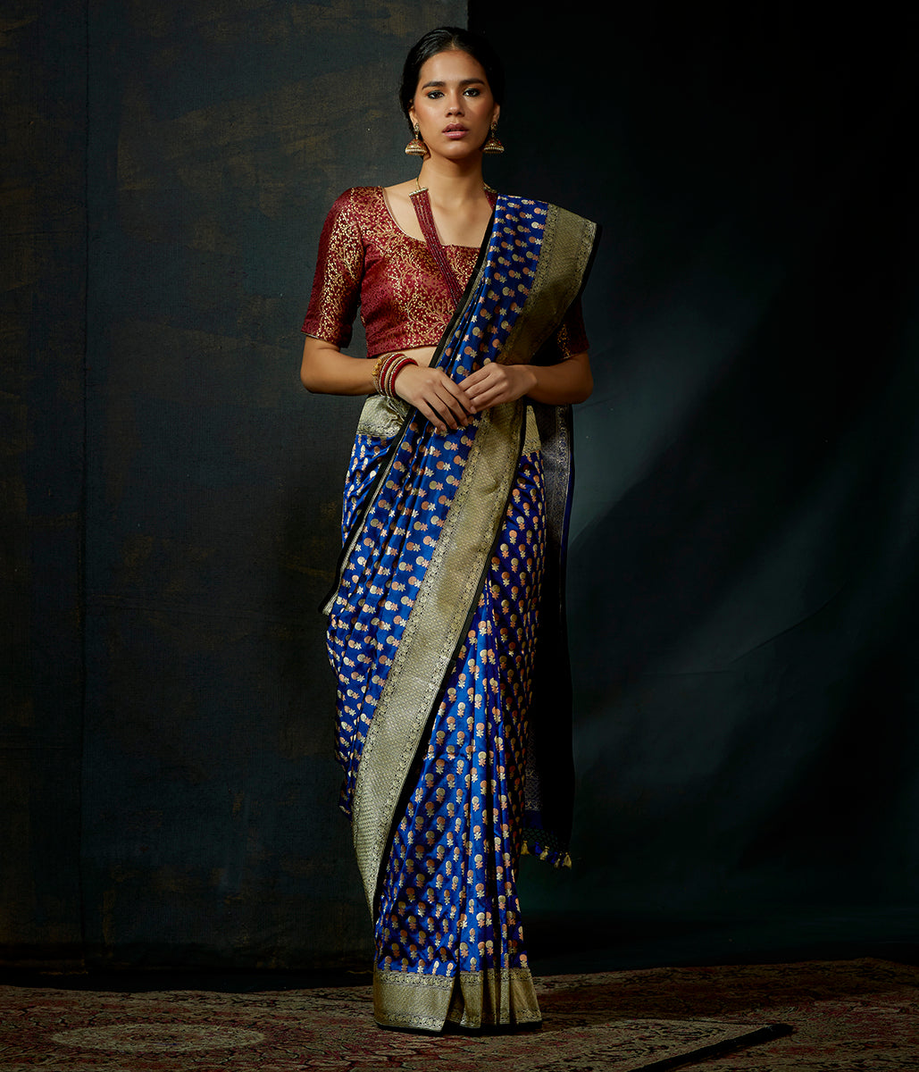 Royal Blue katan silk saree with small floral motifs and kadhwa border