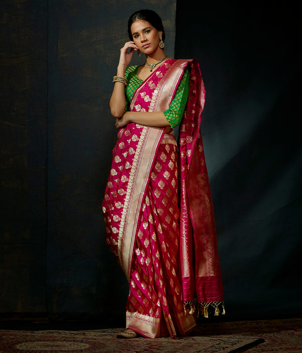 Pink katan silk saree with traditional leaf motifs and kadhwa border