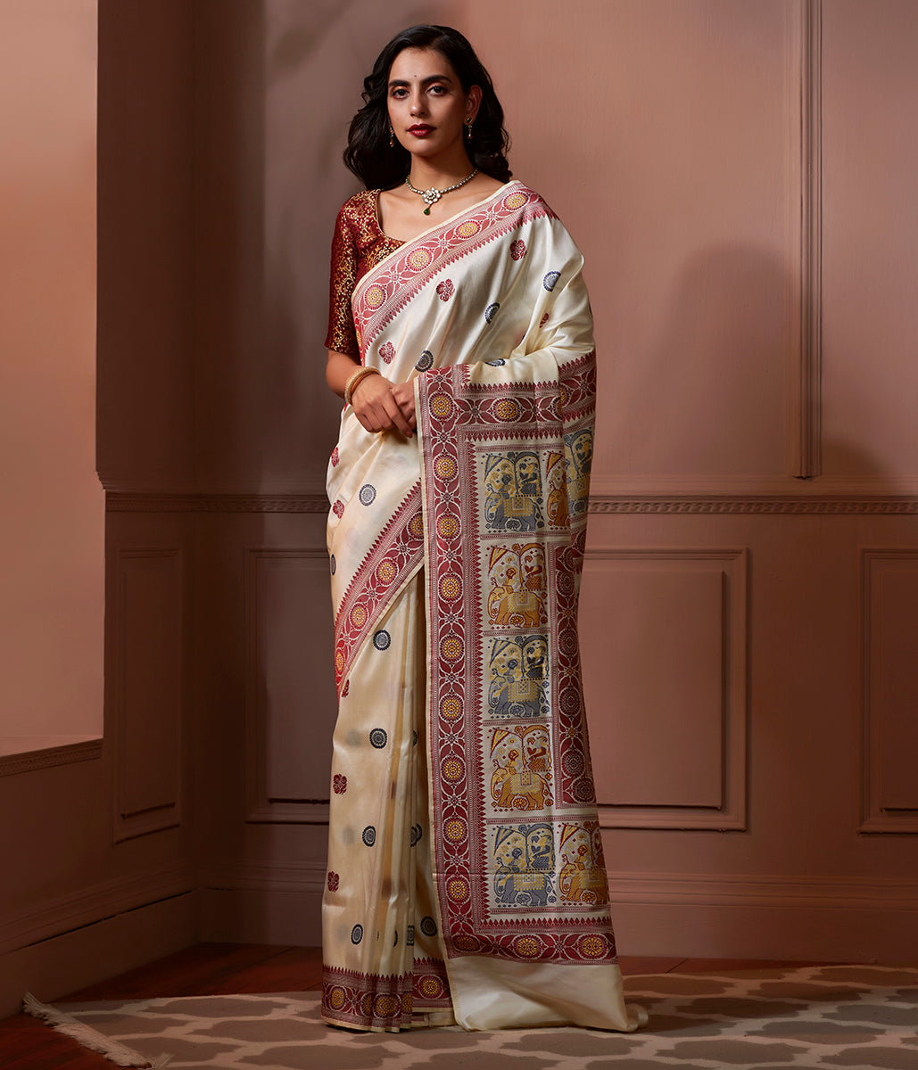 Banaras Baluchari saree in Offwhite with an elaborate elephant pallu