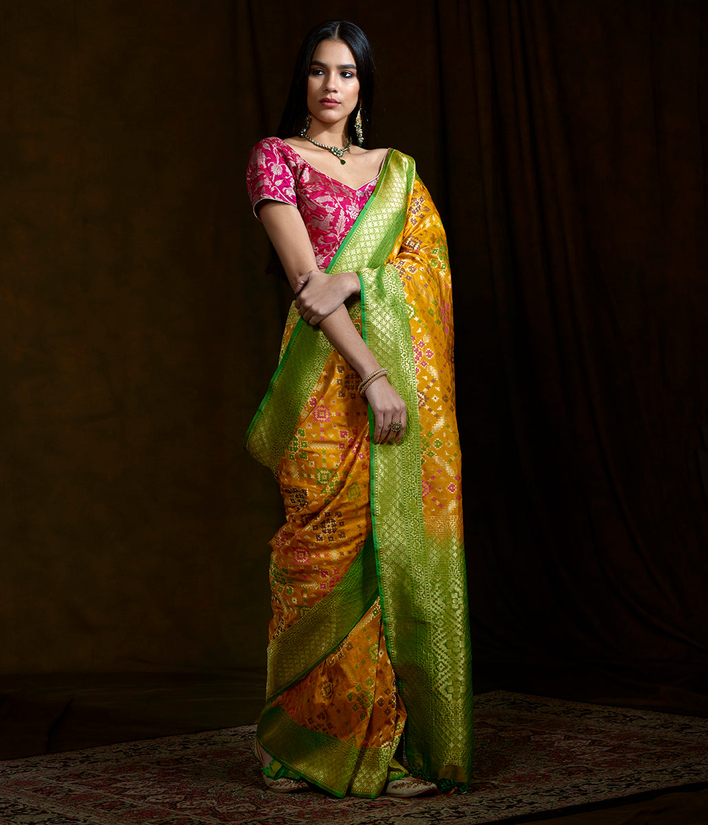 Handwoven Banarasi Patola saree in yellow with a green border