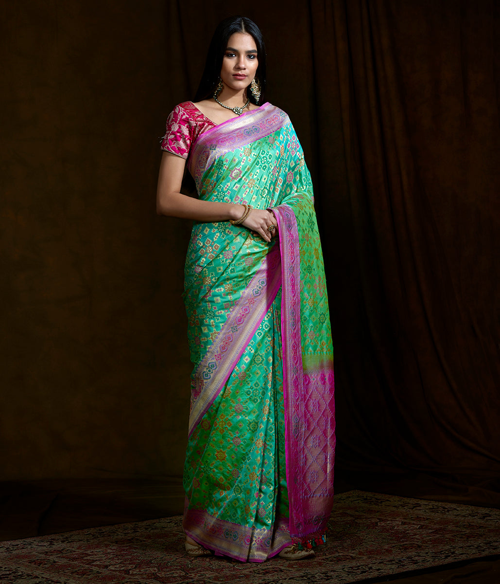 Handwoven Banarasi Patola saree in Green with a mauve border and pallu