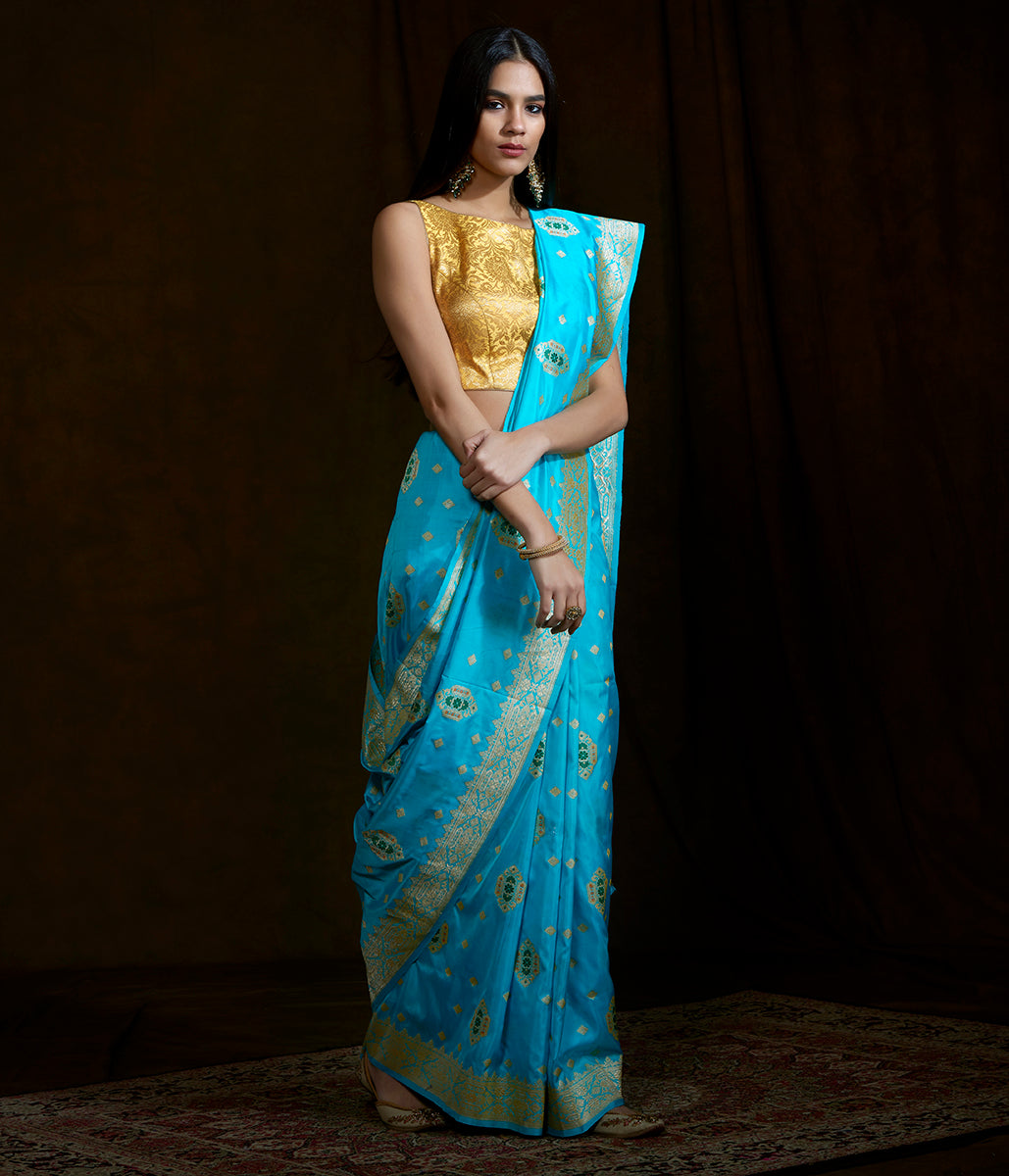 Turquoise blue latan silk saree with meenakari tanzeb booti