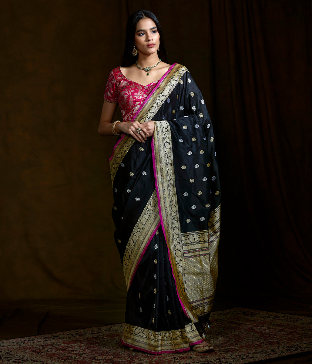 Black kadhwa booti saree with pink selvedge and beldaar border