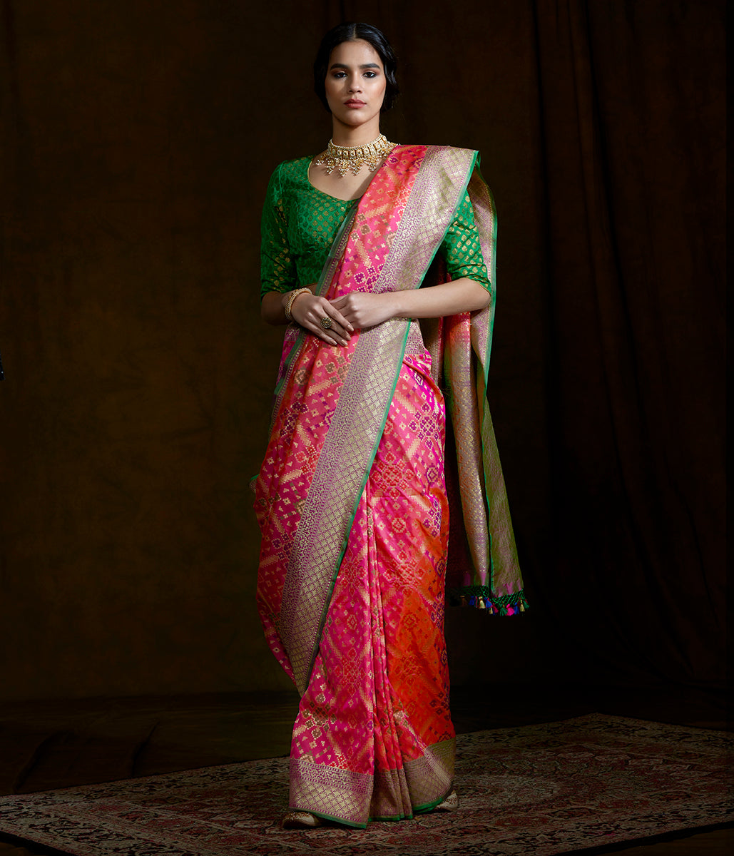Handwoven Banarasi Patola saree in Pink dual tone with a green border