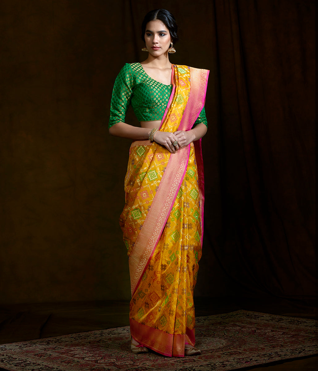 Handwoven Banarasi Patola saree in Yellow with a pink border