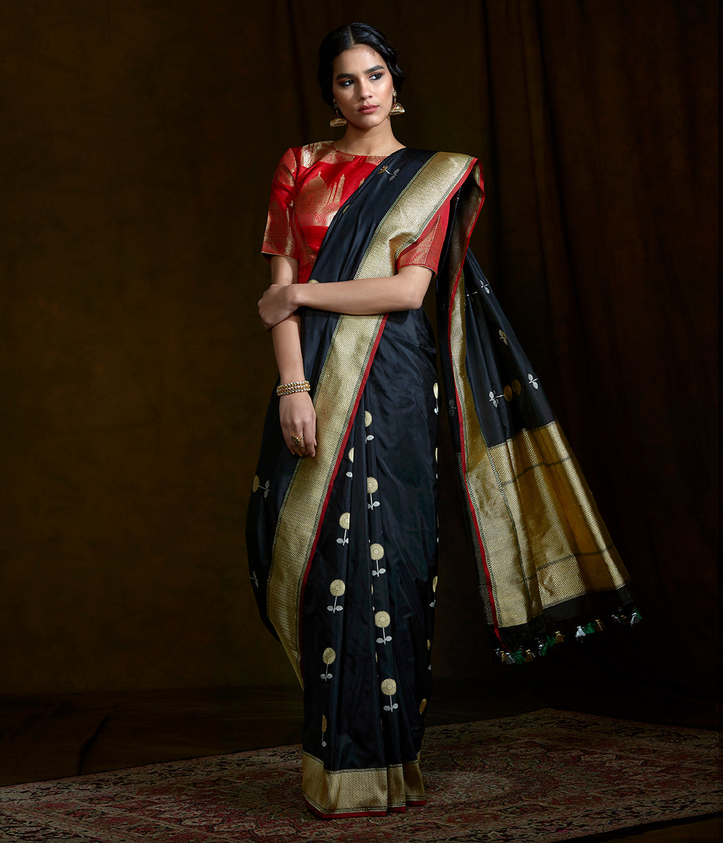 Black kadhwa katan silk saree with floral motifs and red selvedge