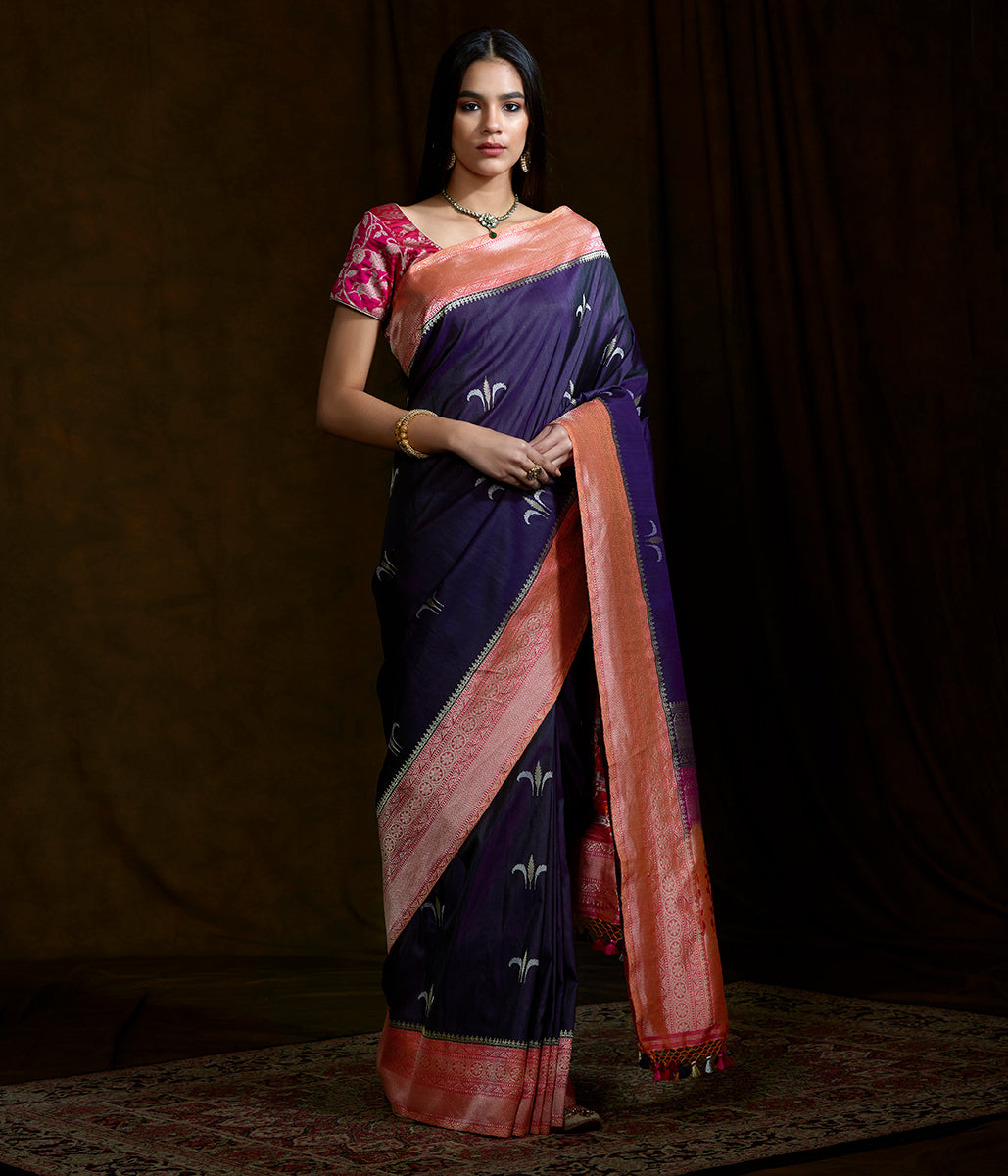 Handwoven banarasi Tusser silk saree in purple with a peach border and floral motifs