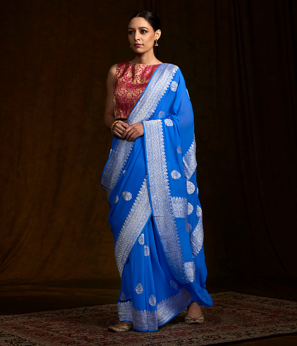 Blue banarasi georgette saree with kadhwa booti