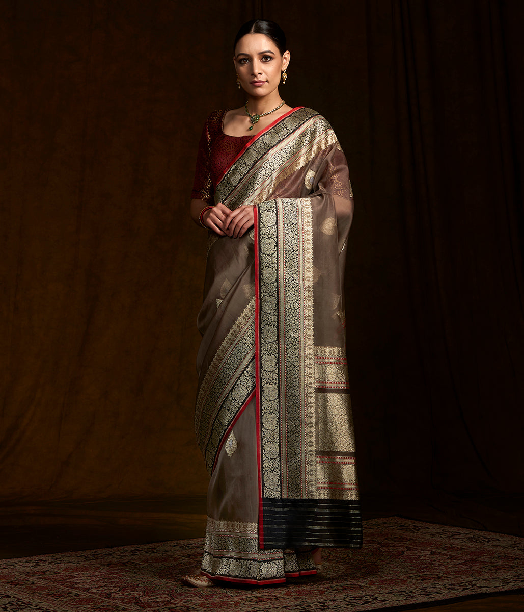 Taupe banarasi kora silk saree with black border and pallu and red selvedge