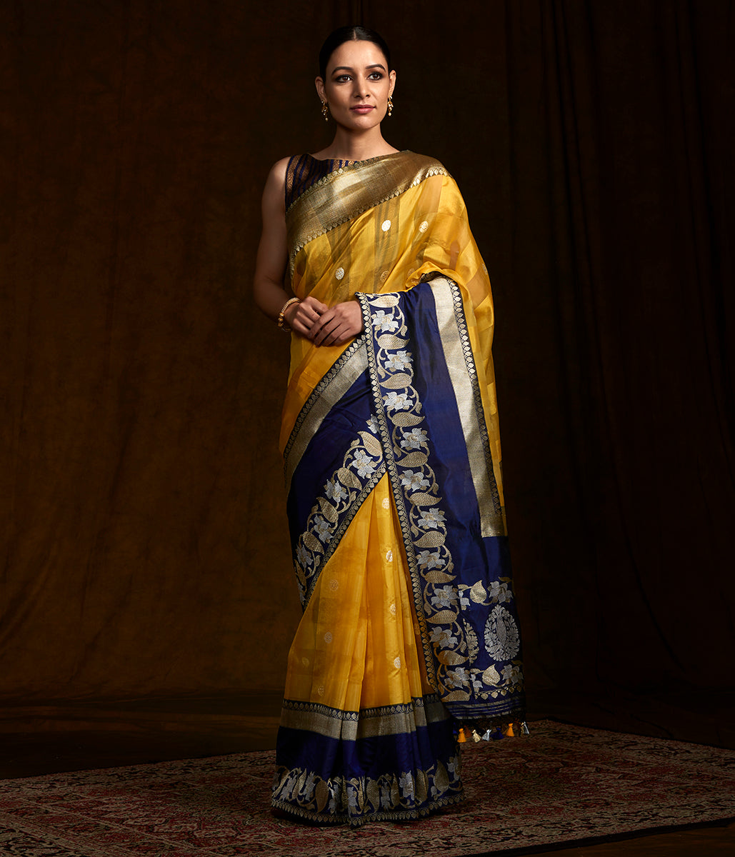 Yellow kora silk banarasi saree with a kadhiyal blue border