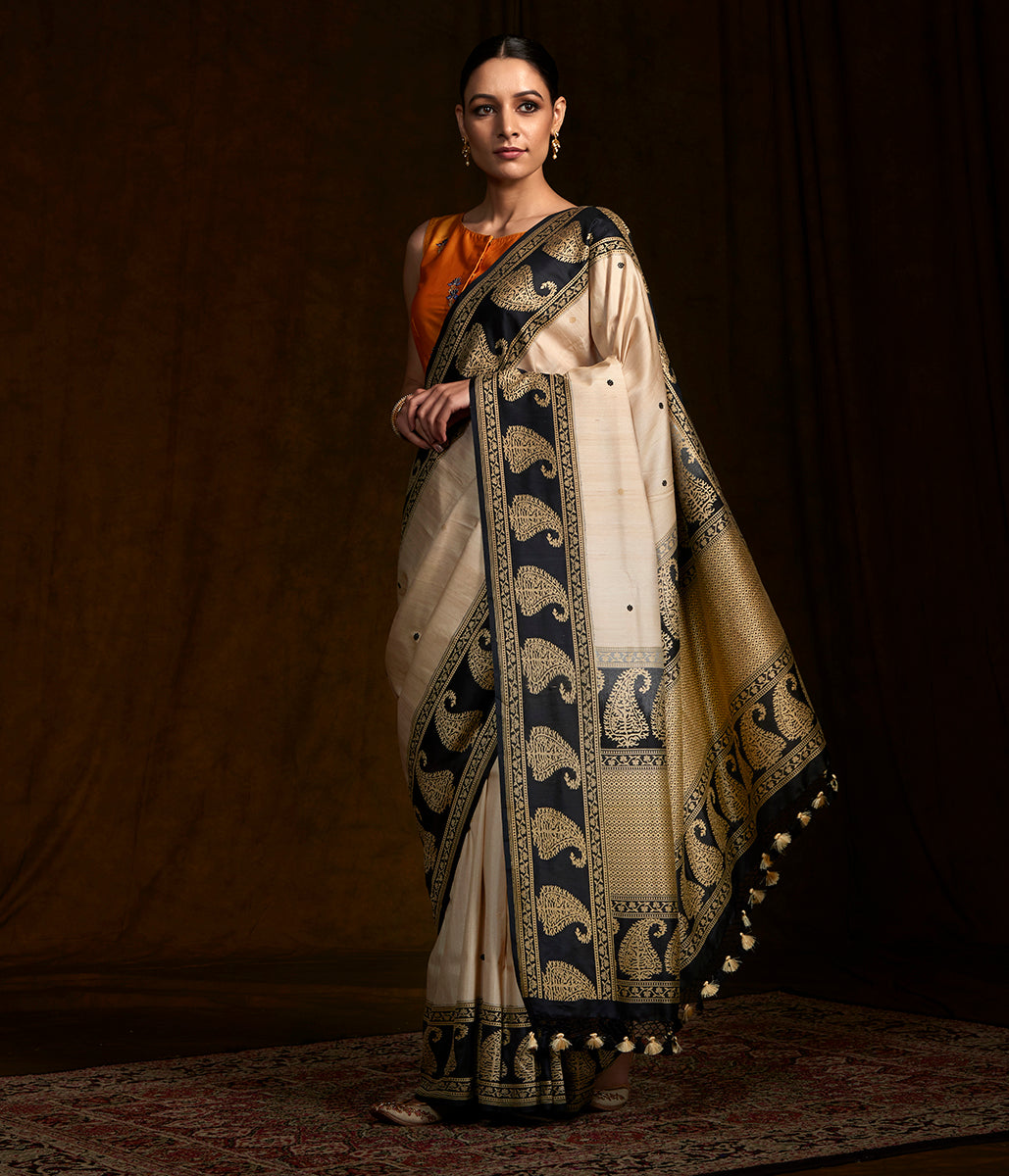 Handwoven banarasi tusser silk saree with katan silk borders and paisley motifs in border