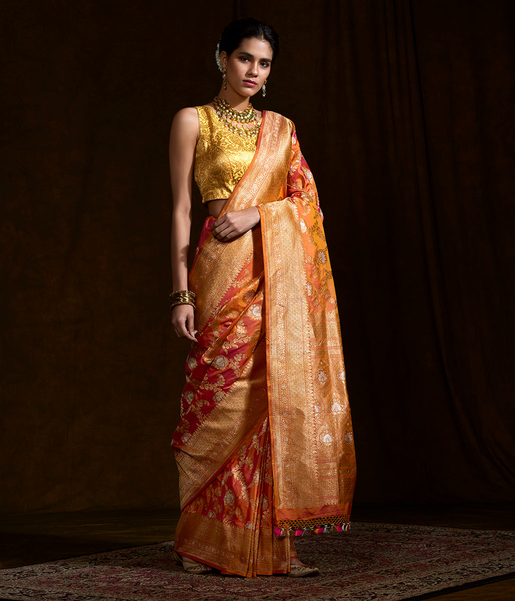Handwoven kadhwa banarasi jangla in a Orange and pink dual tone with sona rupa zari