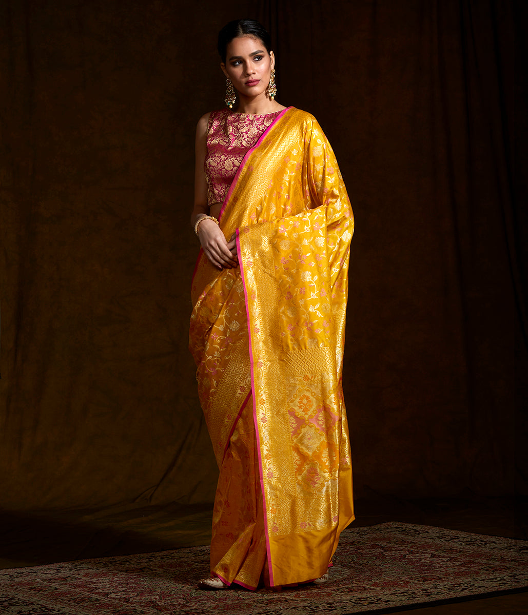 Handwoven Banarasi katan silk saree in mustard yellow with meenakari jaal